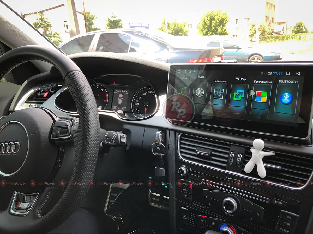 Установленная автомагнитола RedPower 31044 IPS в Audi A4
